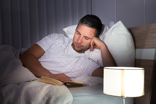 Reading In Bed Helps Establish Better Sleeping Habits & Rituals