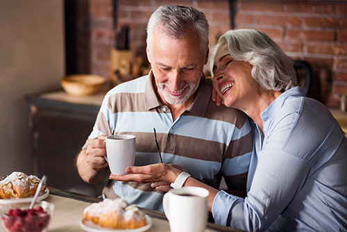 Elderly Couple Enjoying Breakfast