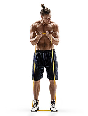 Attractive Man Using a Resistance Band